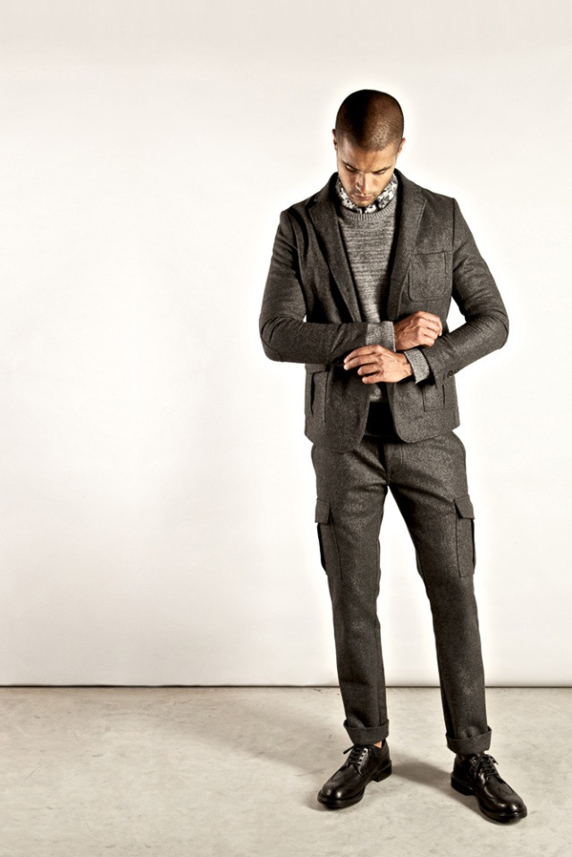 Wings and Horns - Exaggerated lines - slim fitting trousers in a classic grey wool have been made unusual by adding cargo pockets and rolled hems.