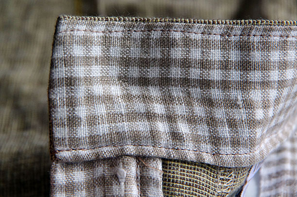 Finished button inside waistband
