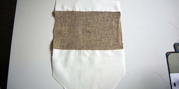 Pocket facing topstitched to lining