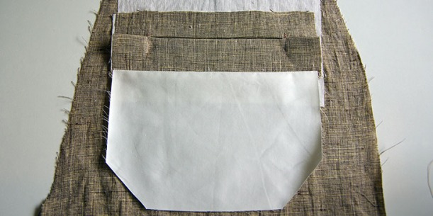 Pocket lining pressed downwards