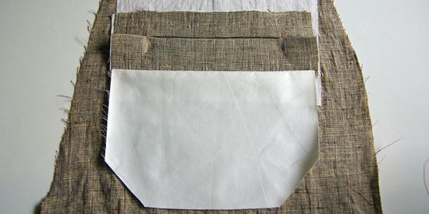 Pocket lining pressed downwards