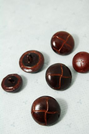 Braided leather button